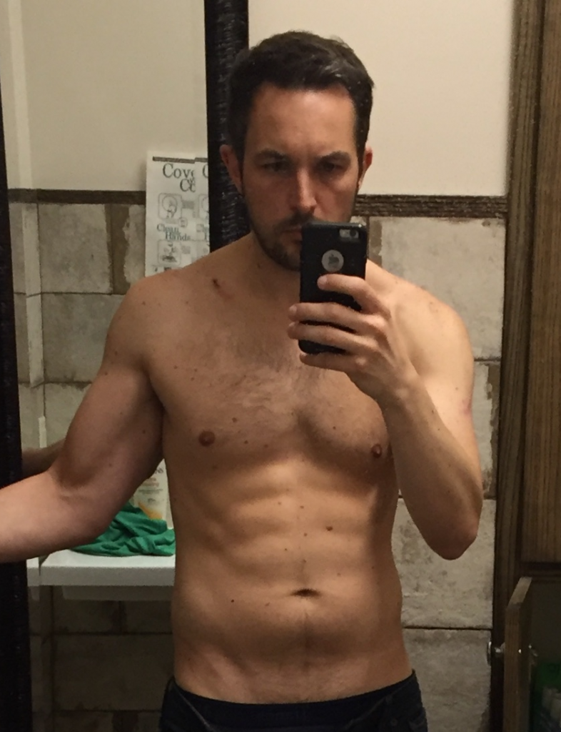 Coach Flick with visible 6-pack abs after losing tons of fat to get down to 180 lbs.